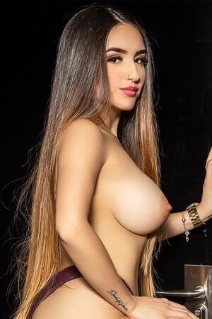 Young Venezuelan escort in Barcelona showing a breast, Julieta