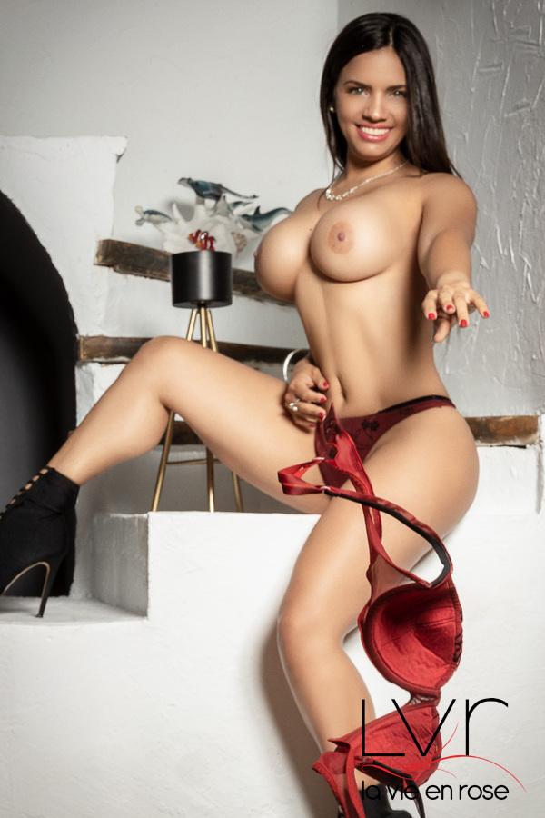 Luxury escort for GFE in Barcelona throwing a bra, Nikol