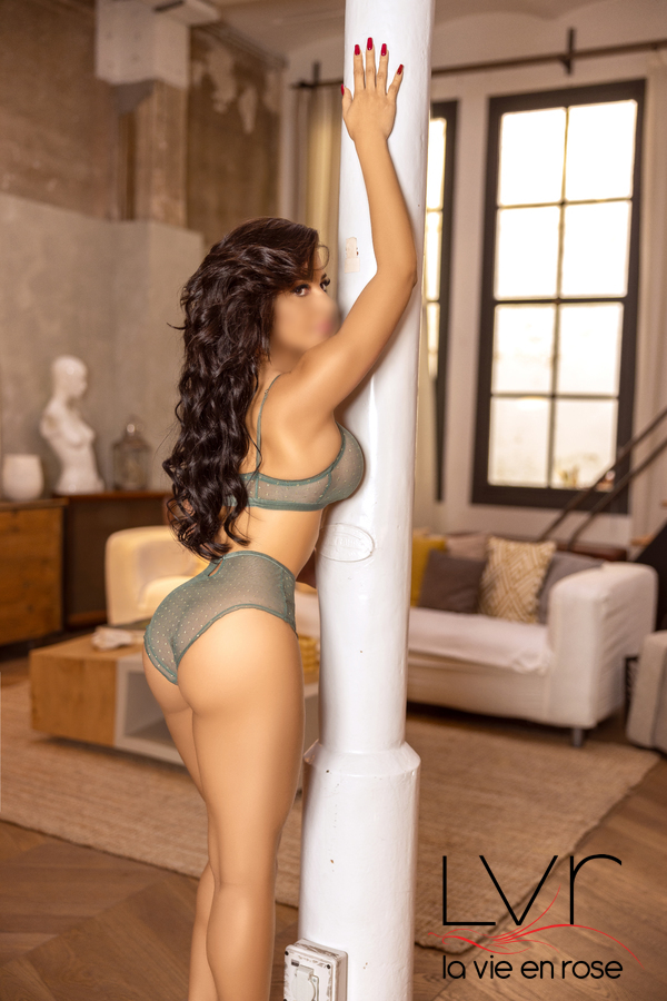 Brazilian Escort in Barcelona standing on a column, Isabella