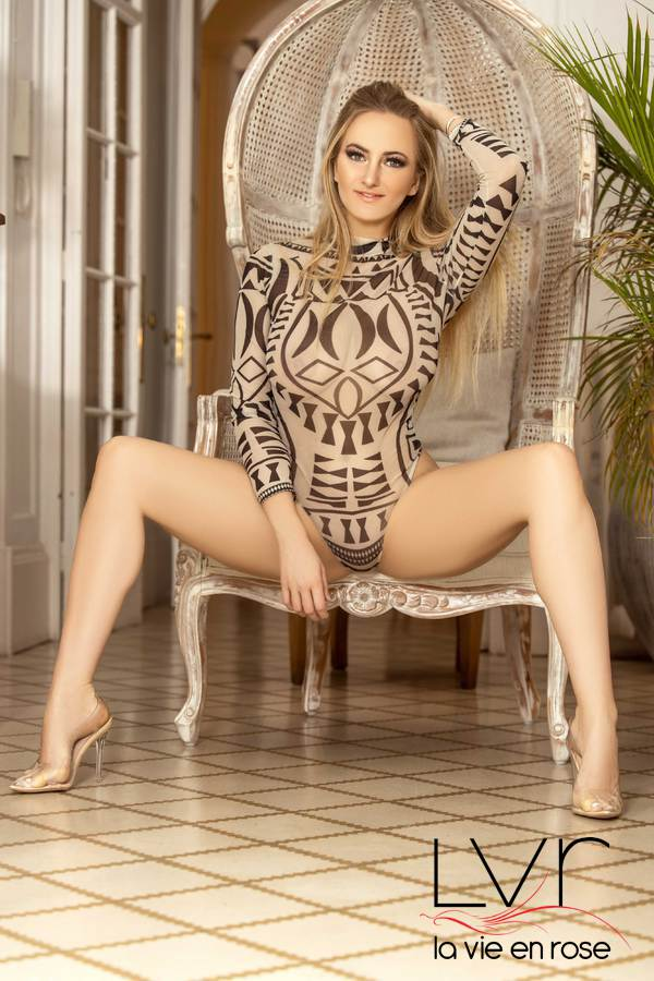 Blond French escort in Barcelona in a chair with her legs spread, Blondy